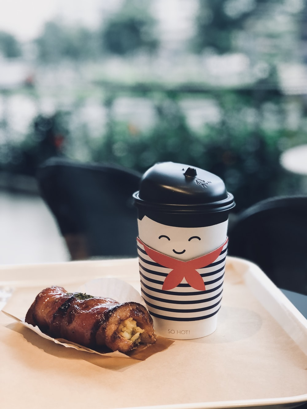 selective focus photography of food beside white disposable cup