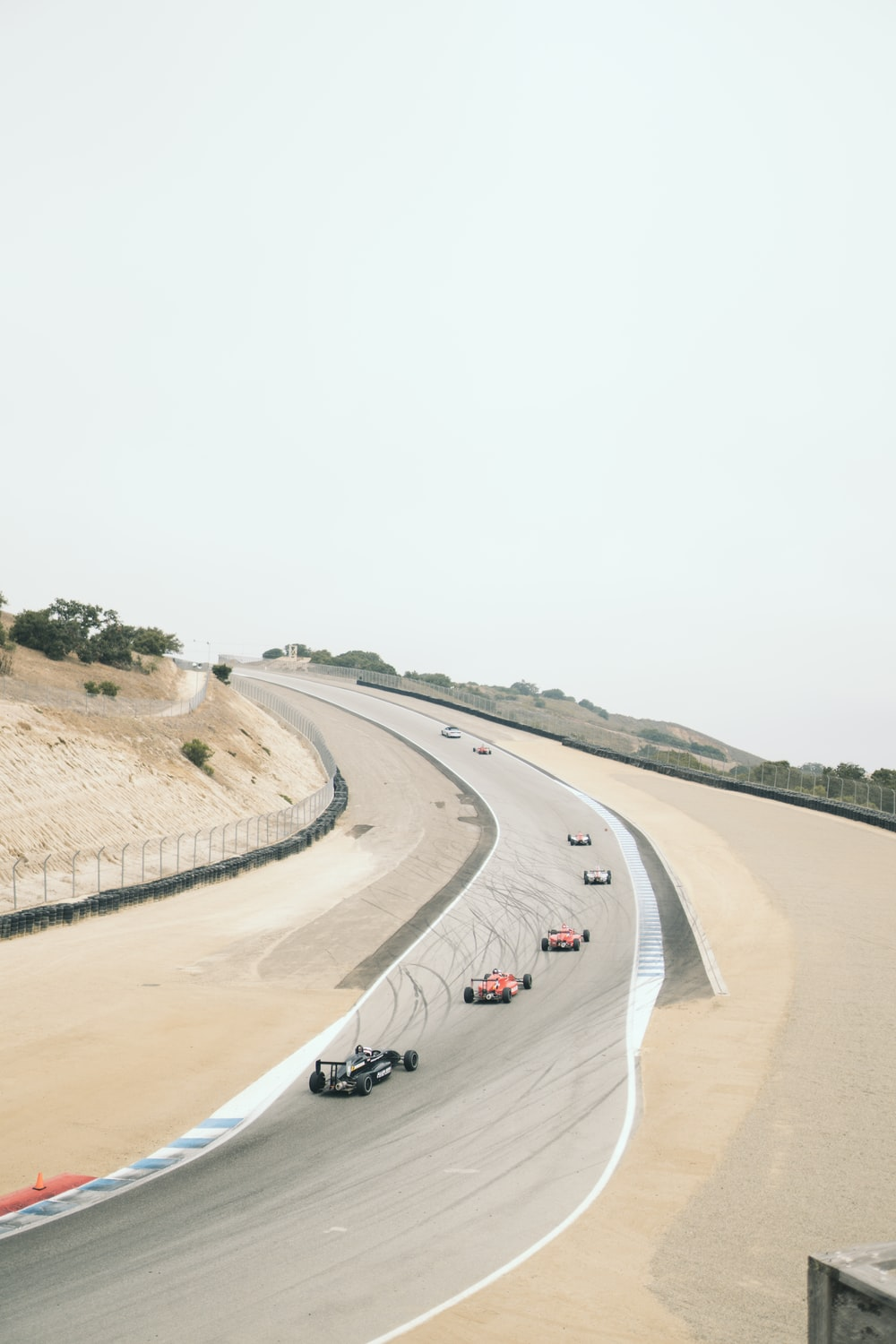 aerial photography of vehicles doing racing during daytime