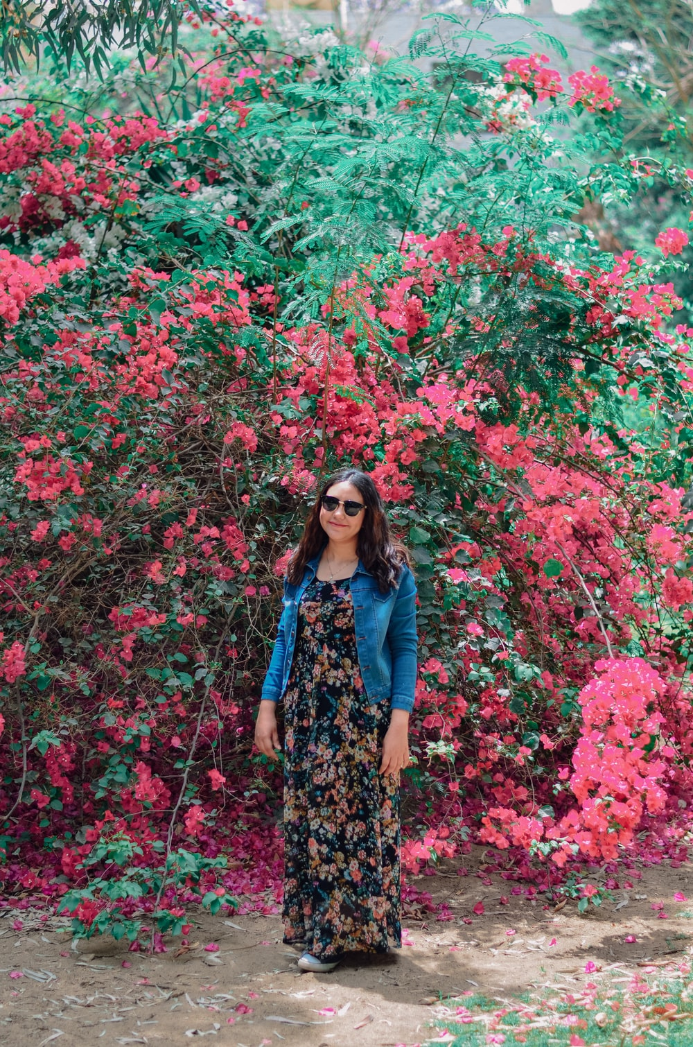 black and brown floral dress standing beside flower