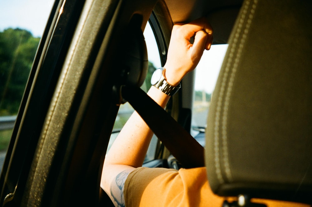 person sitting inside car during day