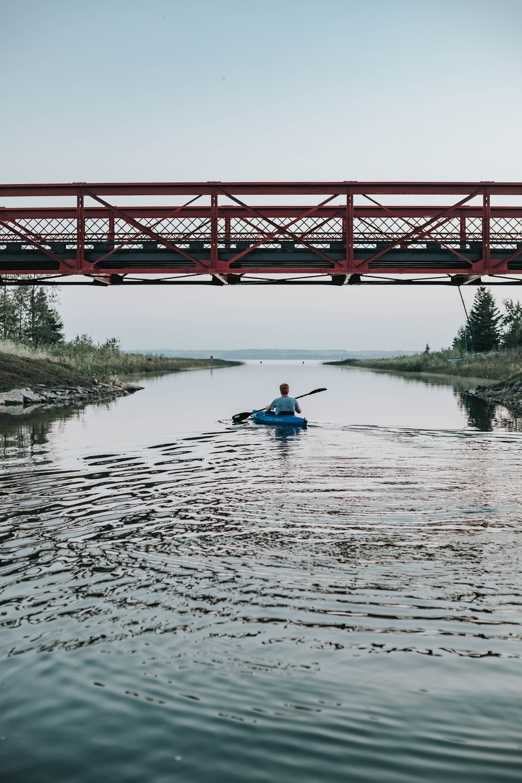 man riding kayak
