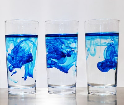 three drinking glasses glass teams background