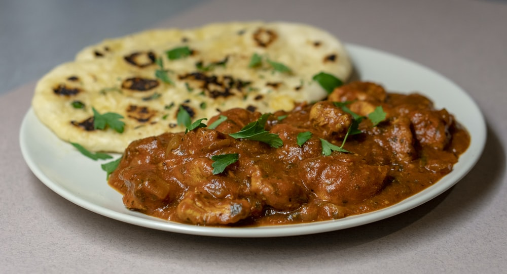 roti and meat slices with sauce on plate