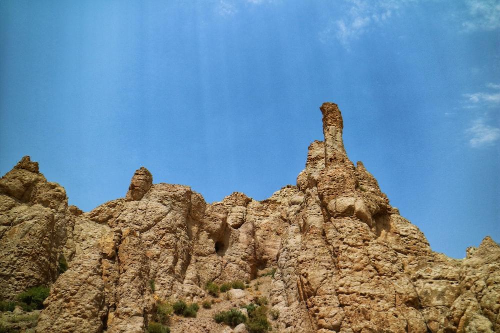 rocky outcrop under blue sky