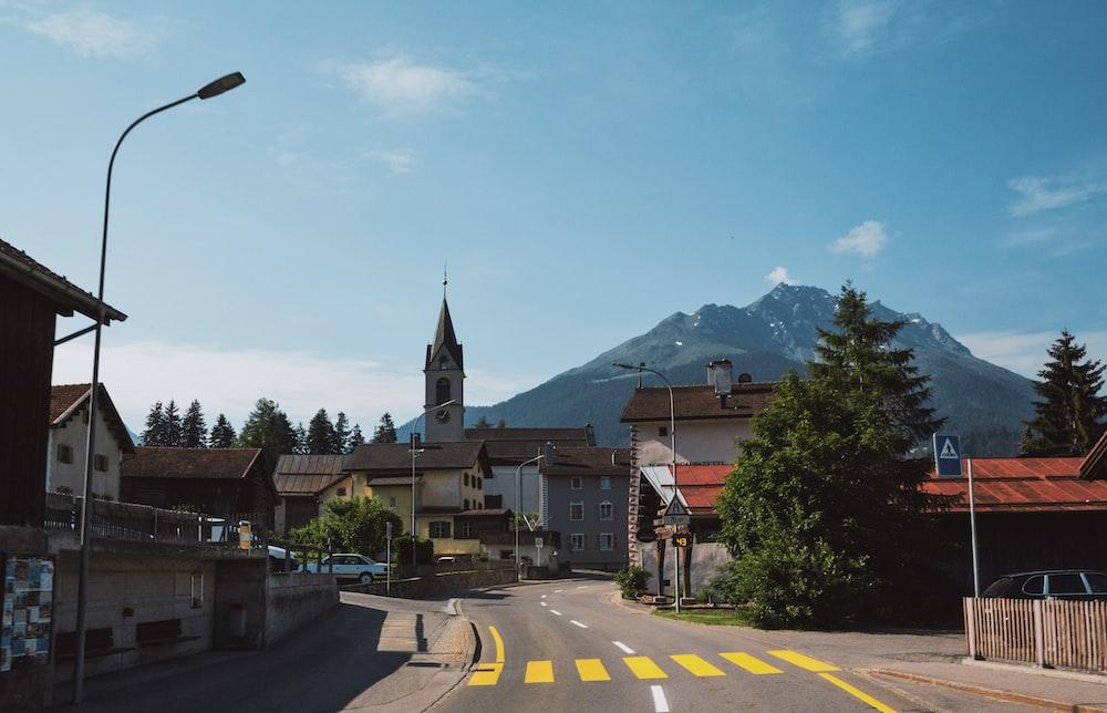 road between buildings under blue sky