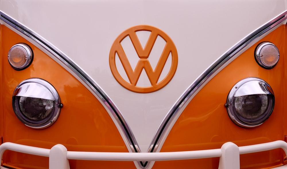 white and orange Volkswagen T1 van
