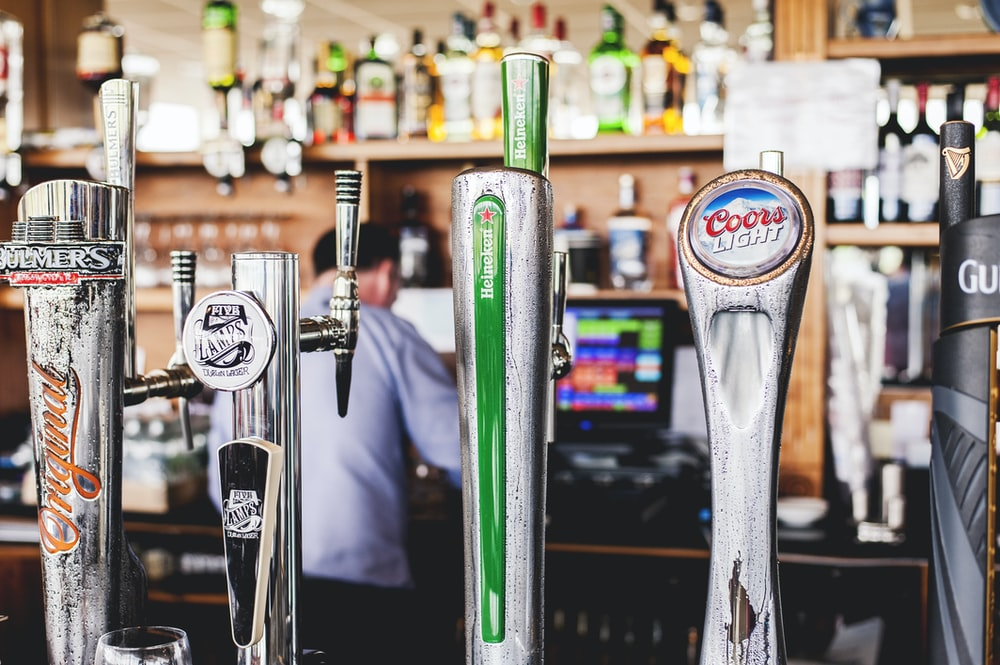four silver beer tap handles