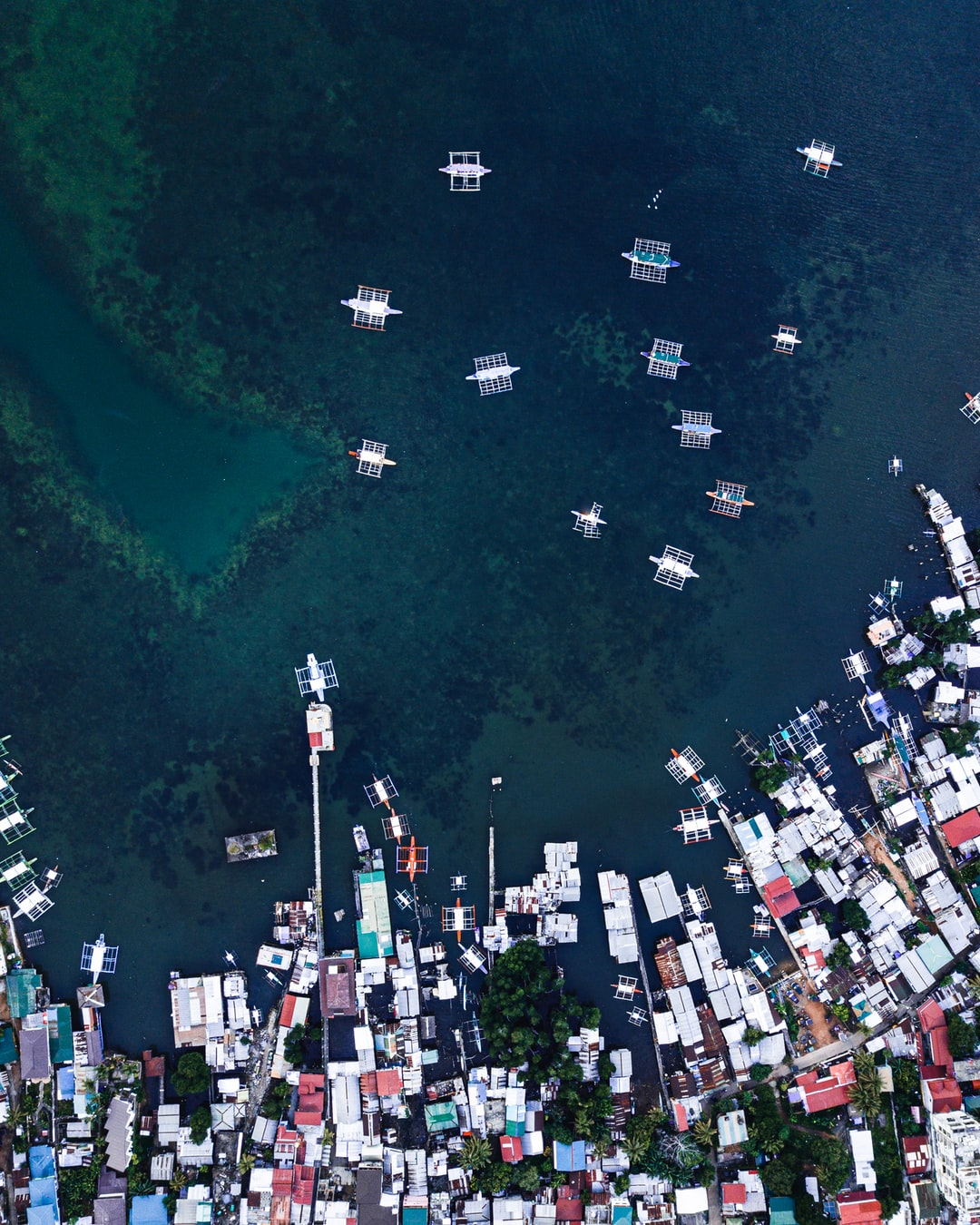 Cenital shot of the the boats in the port of Coron Town in Palawan, the Philippines