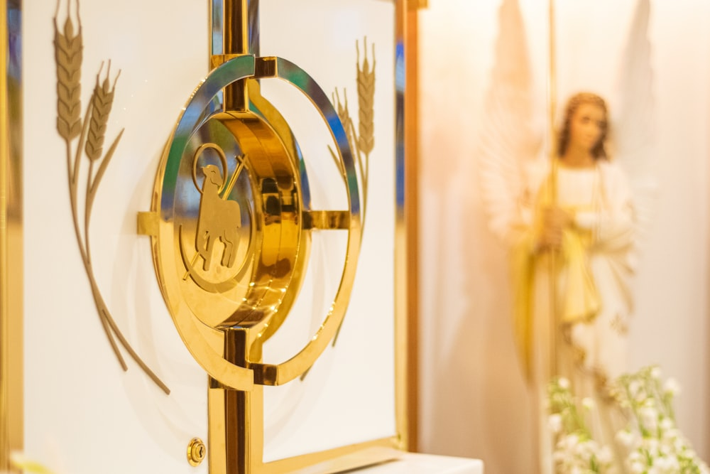 gold decor near angel figurine