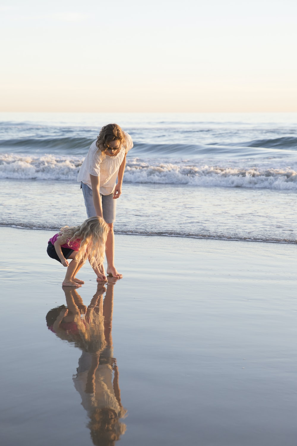 woman and girl on seashore