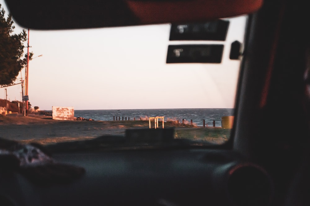 view of beach from vehicle inside during daytime