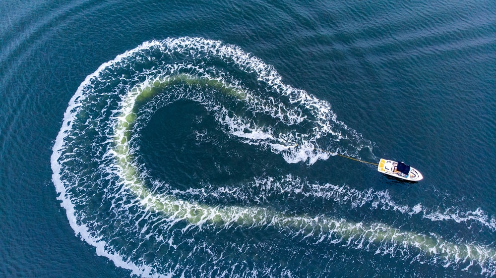 aerial view of boat on water during daytime