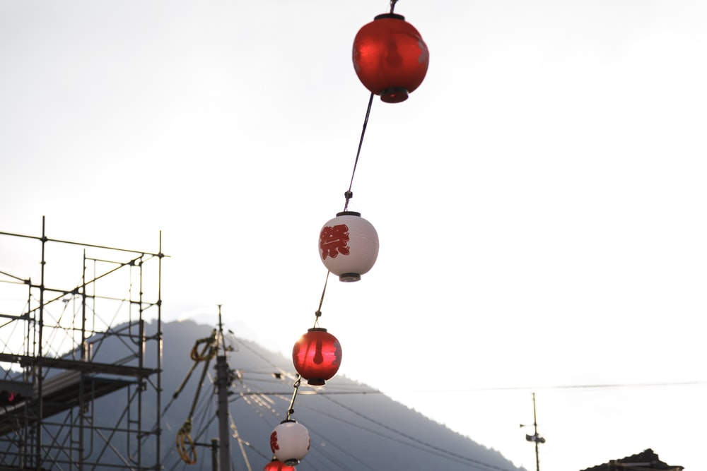 red and white hanging lanterns outside building during daytime