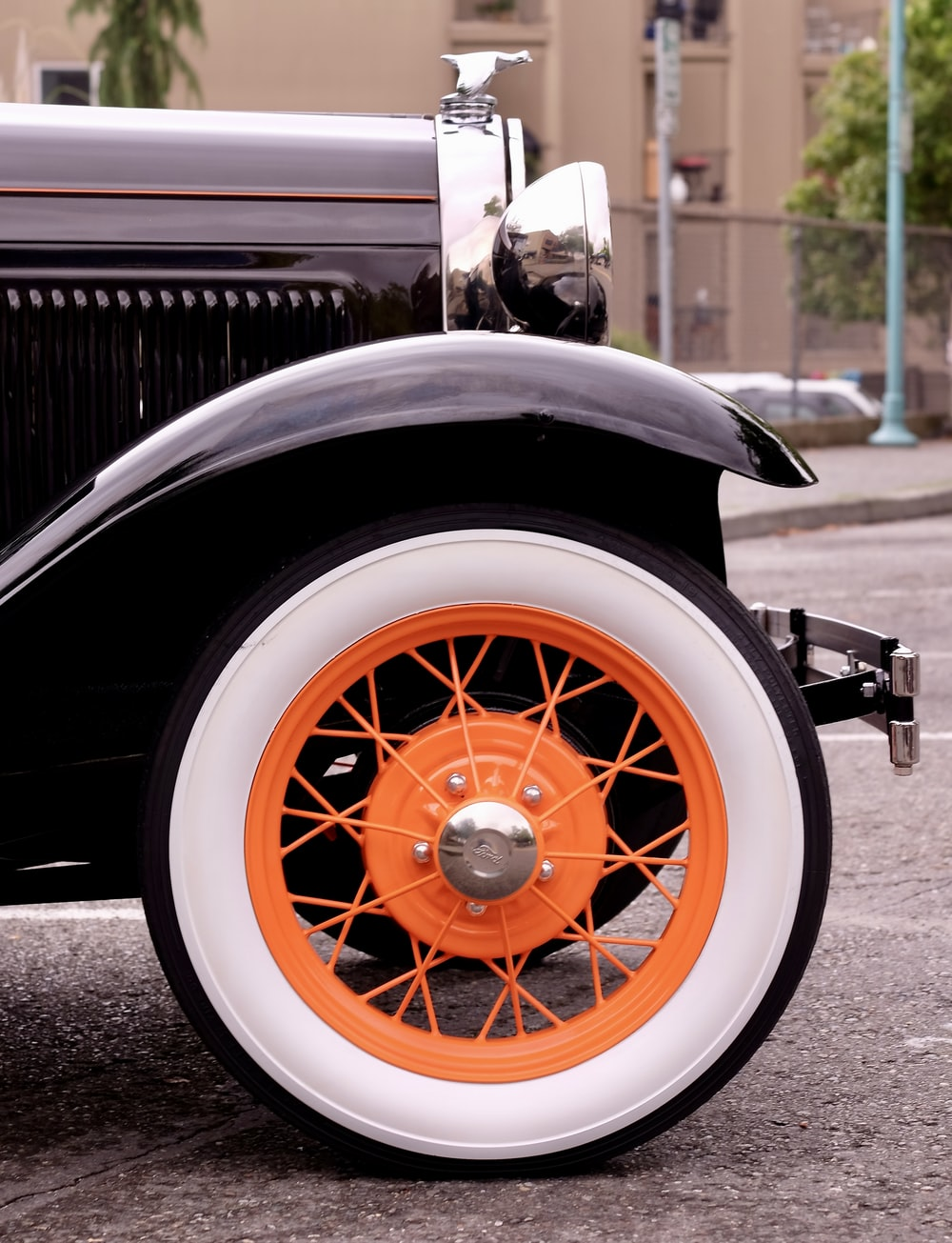 closeup photography of vintage black vehicle