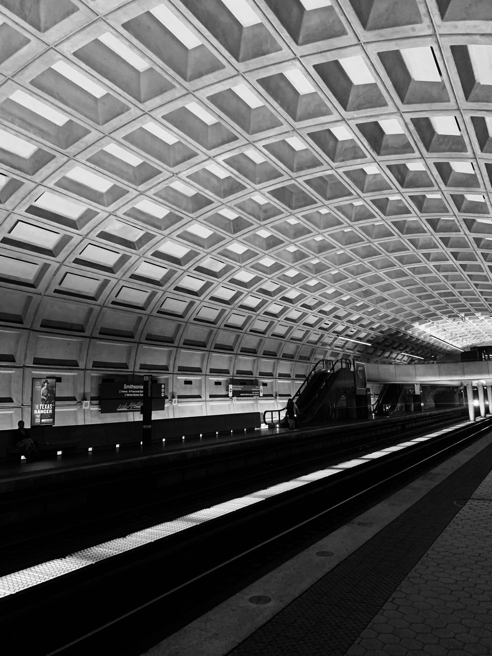 empty subway train station greyscale photography