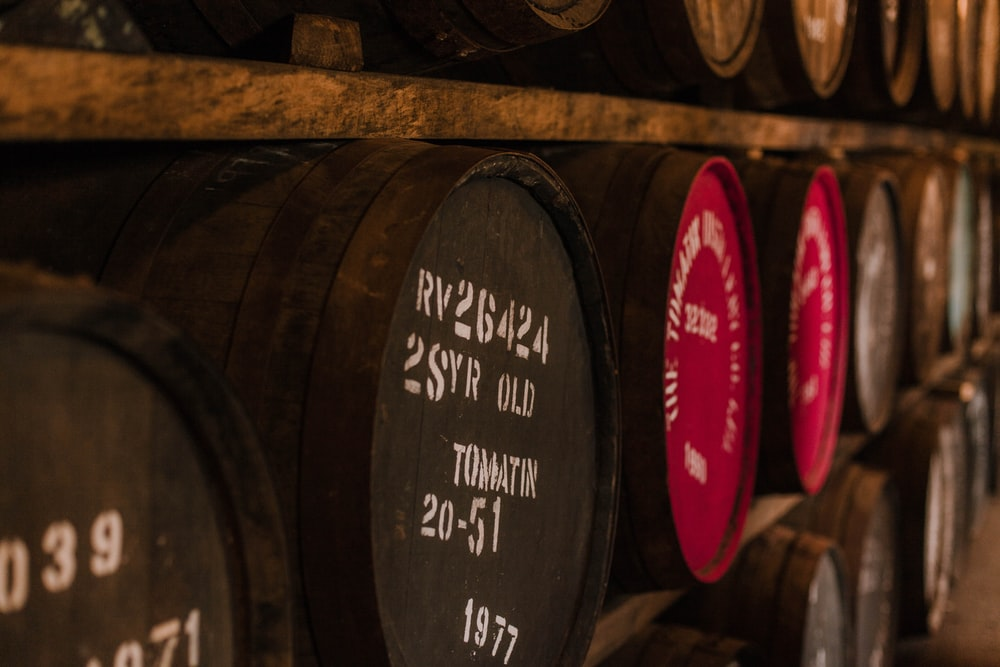 lots of wooden wine barrels stacked