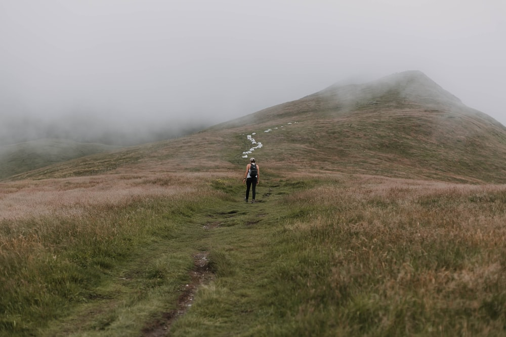 woman in the middle of the mountain