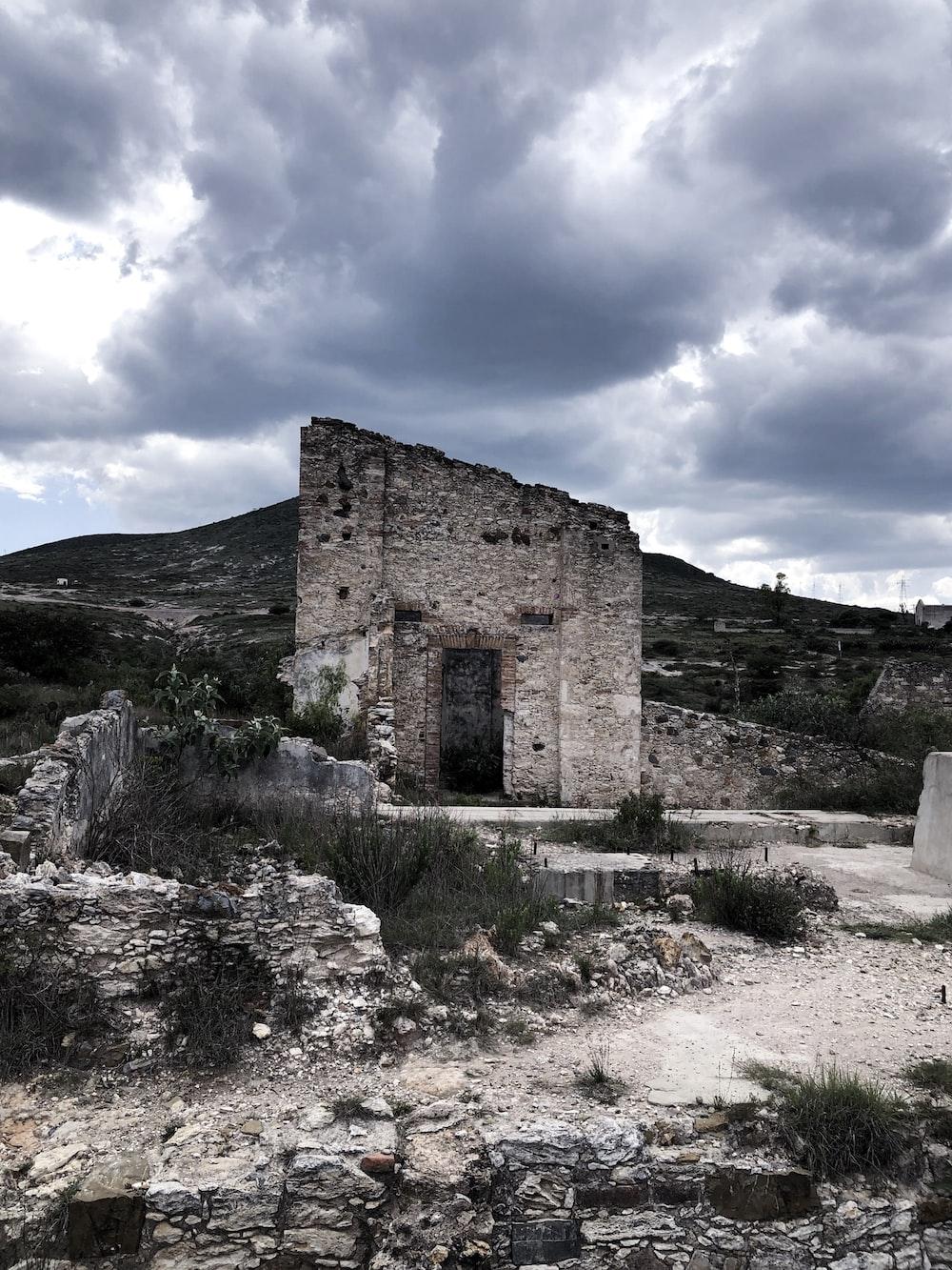 ruins under stratocumulus clouds