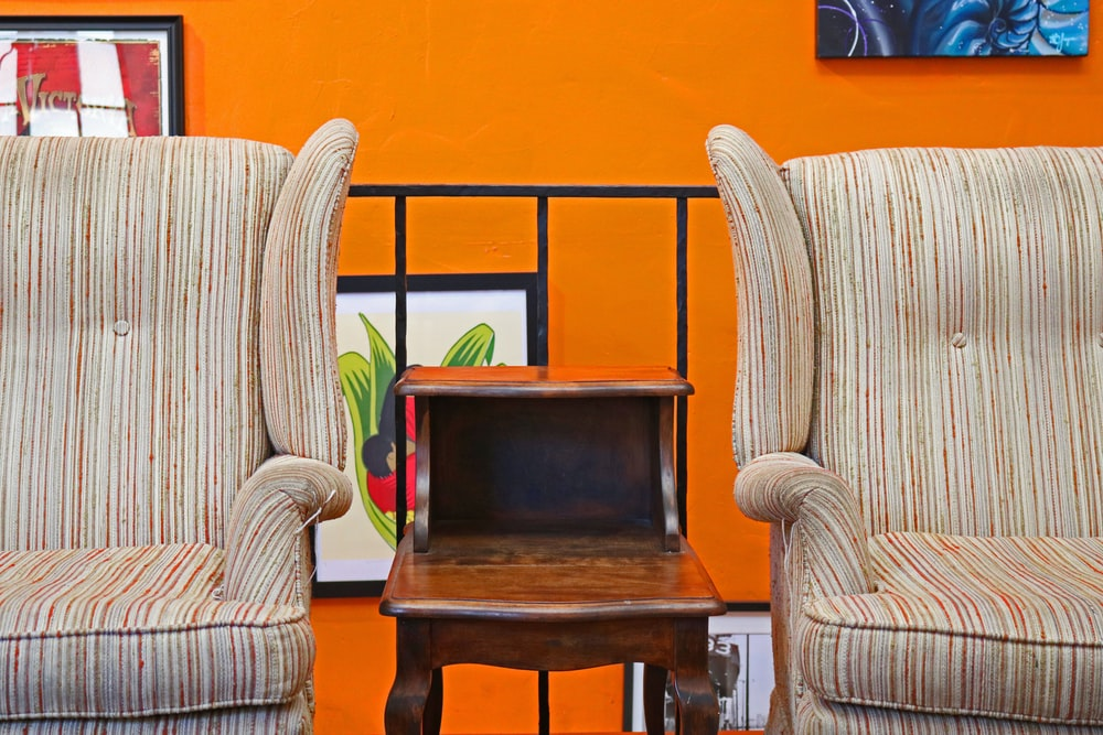 vacant beige striped armchairs