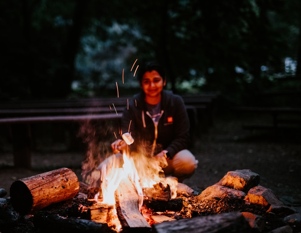 woman cooking marshmallow