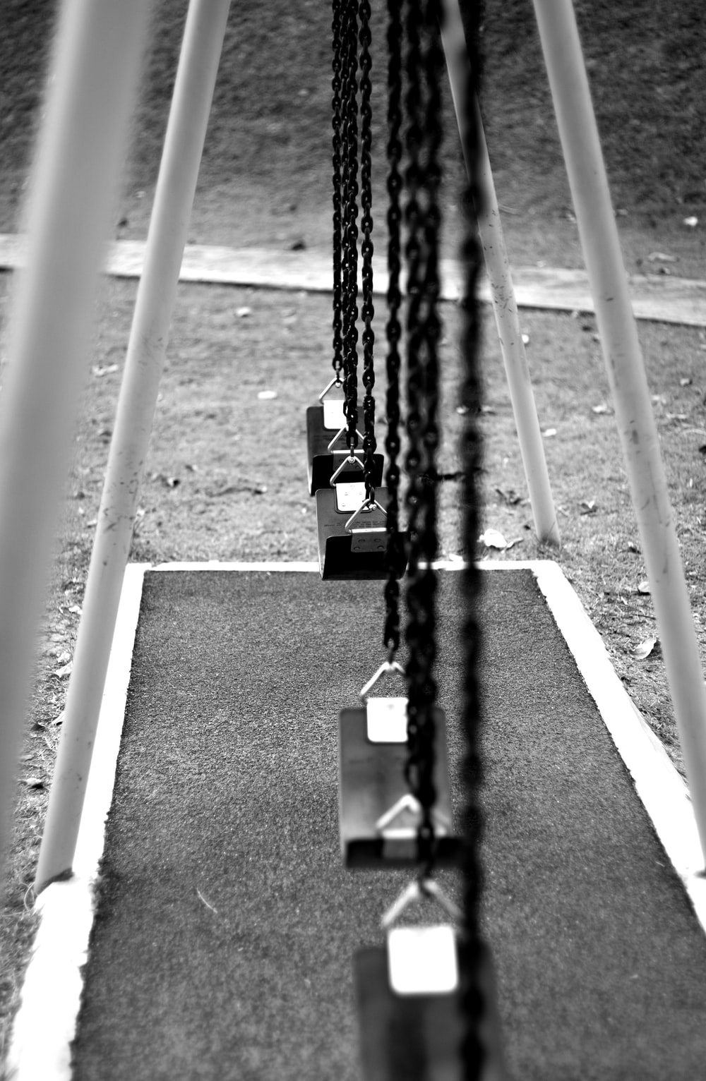 grayscale photography of swings