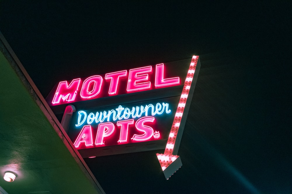 turned-on Motel Downtowner Apartments neon light signage