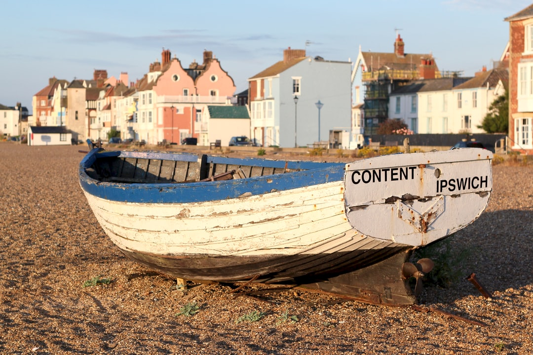 Fishing boat at sunrise on the beach at Aldeburgh.