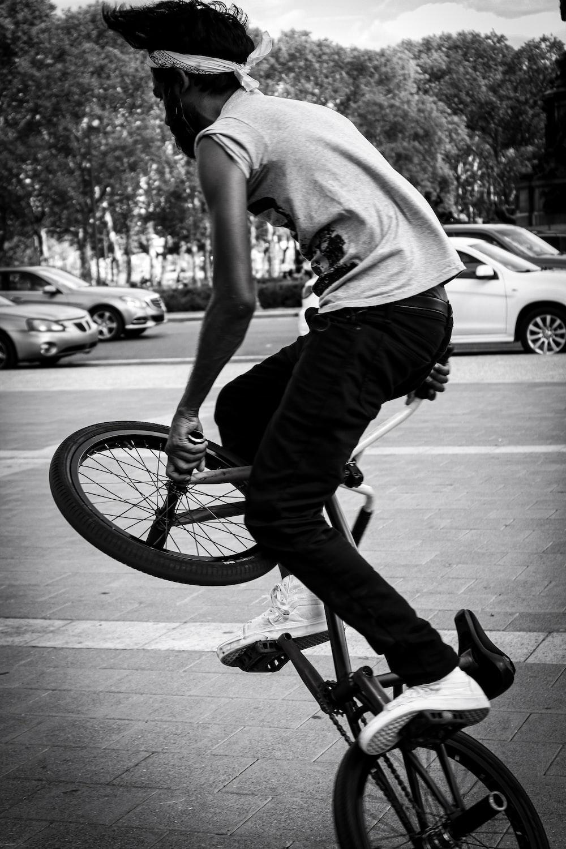 man riding on BMX