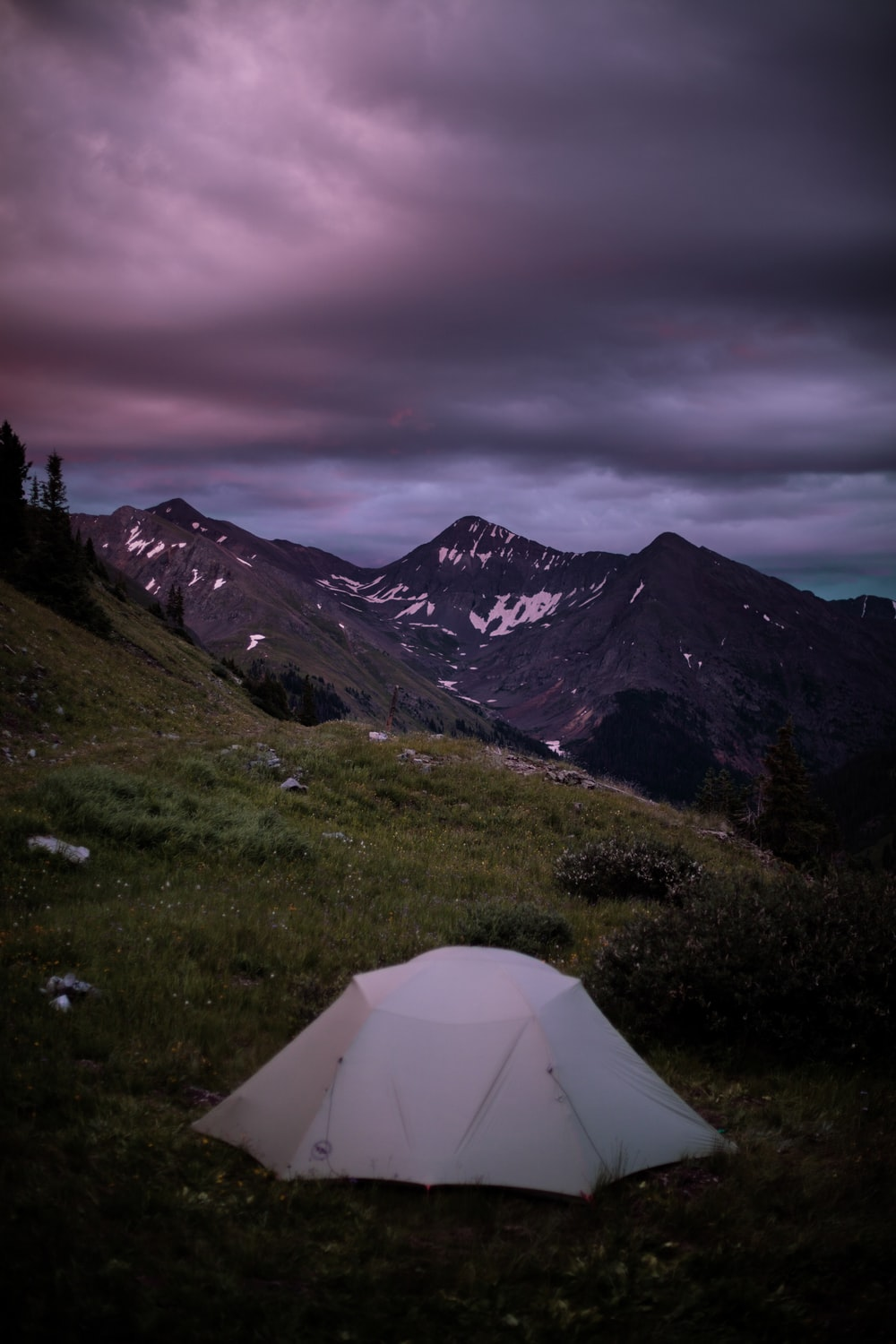 white cabin tent in the mountain