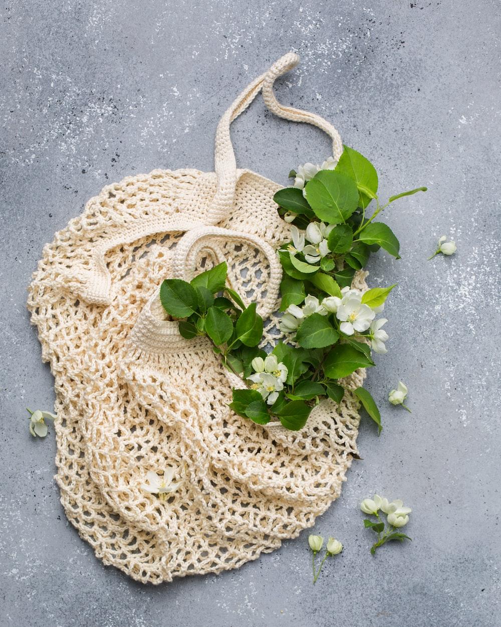 beige net bag with flowers
