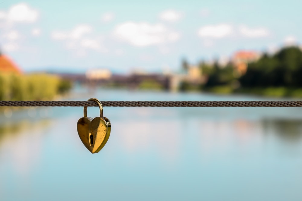 heart brass-colored padlock