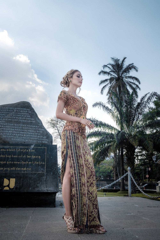 standing woman near rock