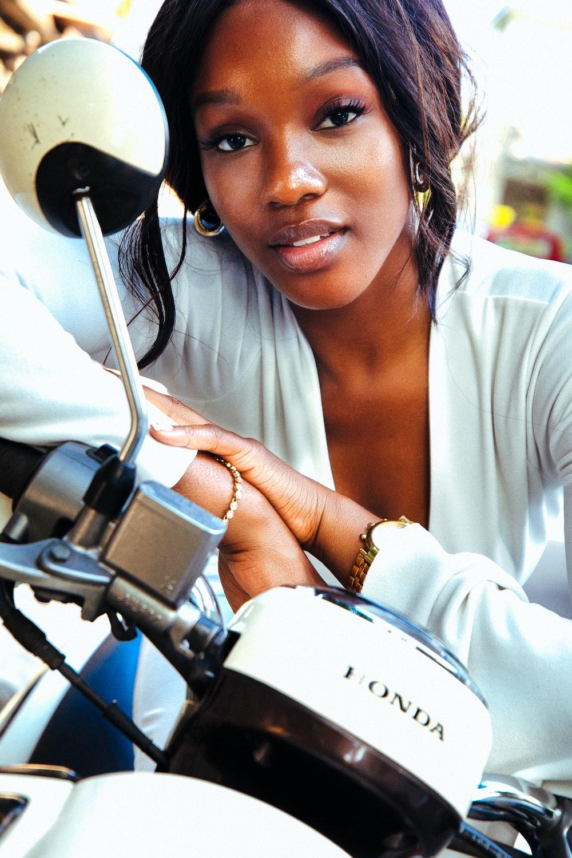 woman riding Honda motorcycle