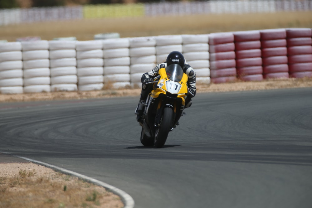 man on yellow superbike in race track