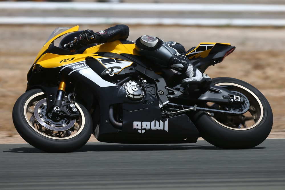 black and yellow sports bike close-up photography