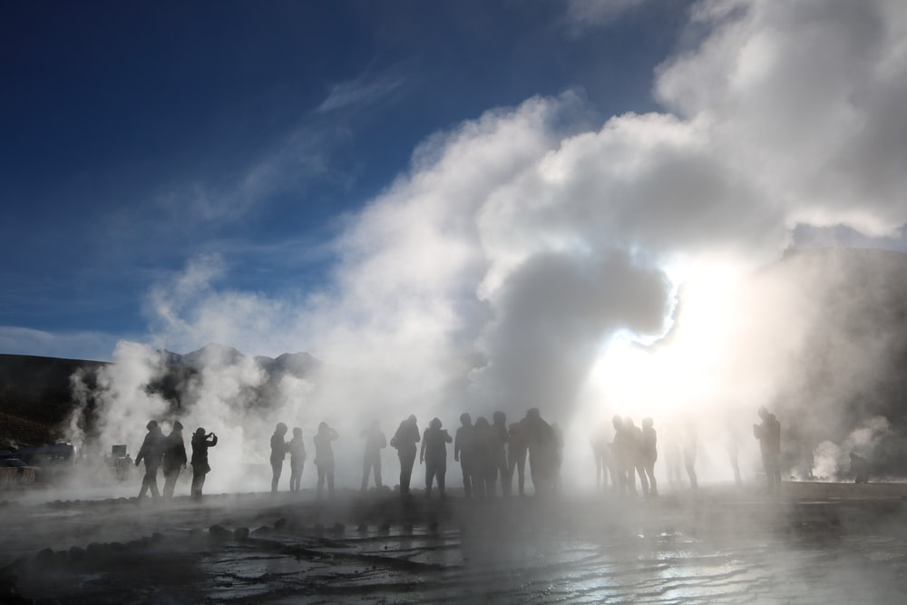 people lot in a smoke during daytime