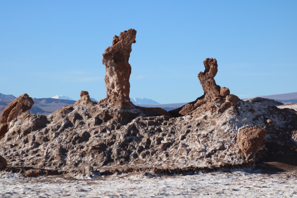 brown and black rock formation under blue sky at daytime