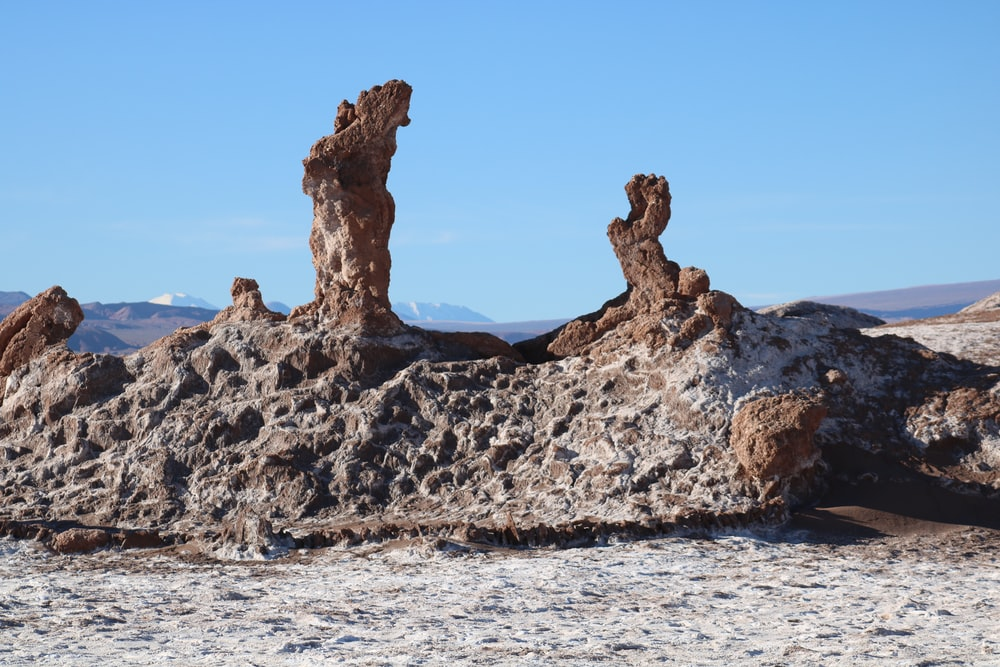 brown and black rock formations under blue sky at daytime