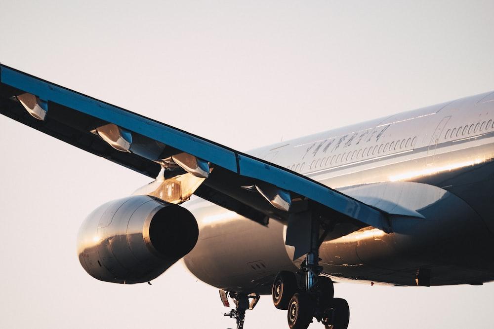 airplane under grey sky