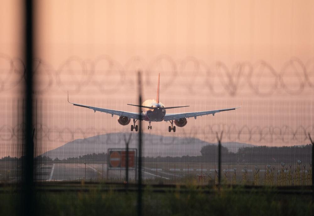 white airbus landing on runway