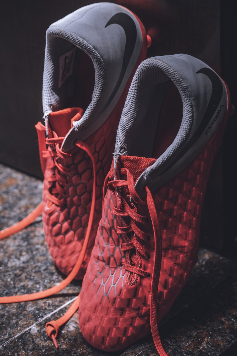 pair of grey and red shoes close-up photography