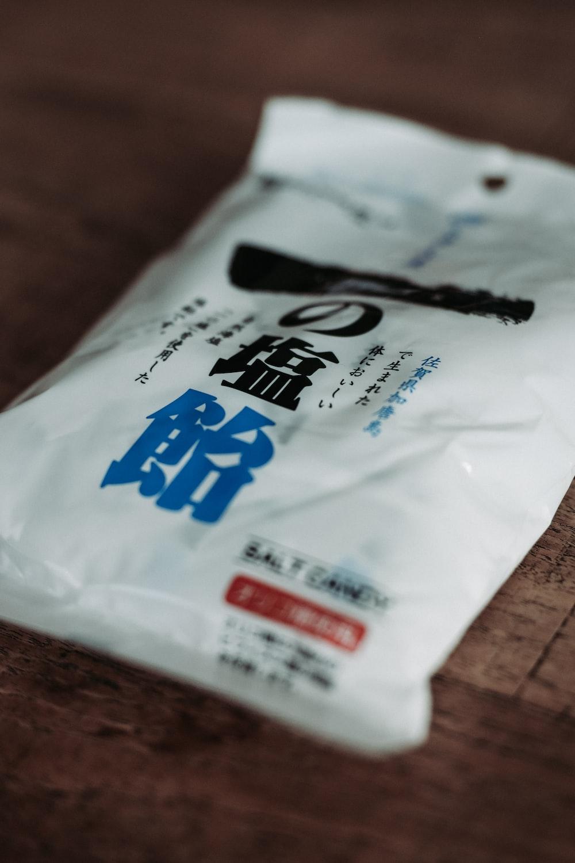 white, blue, and black plastic pack