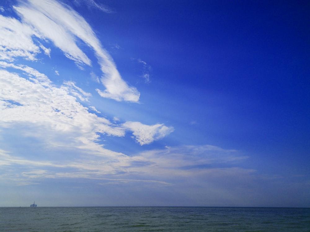 ship in sea under blue sky