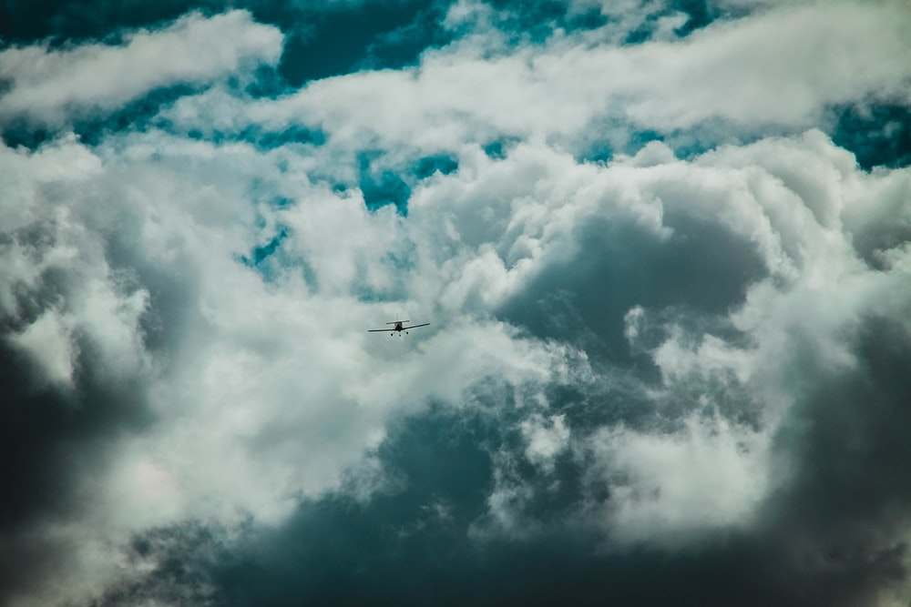 flying plane and clouds