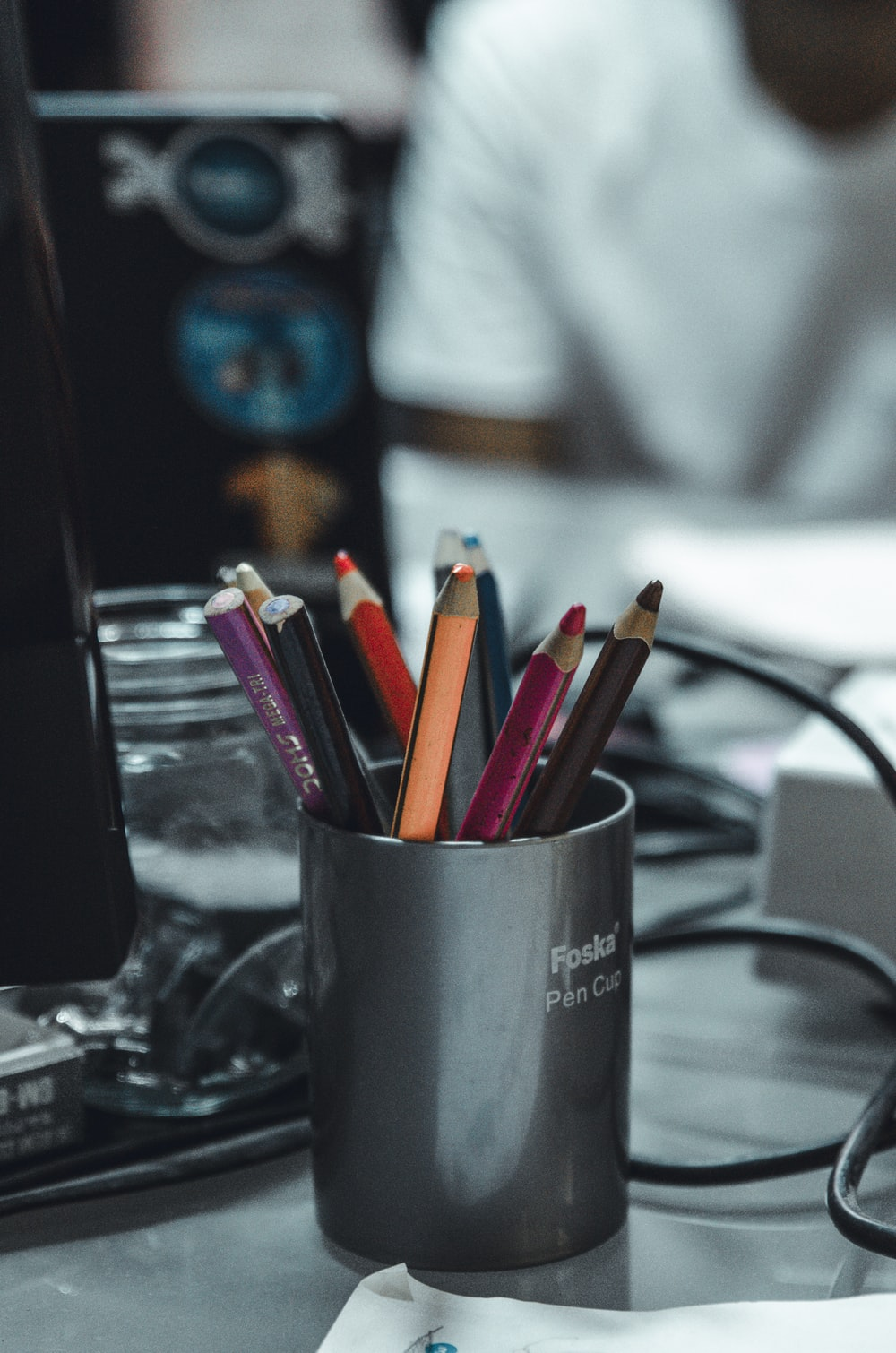 multicolored coloring pencils on black container