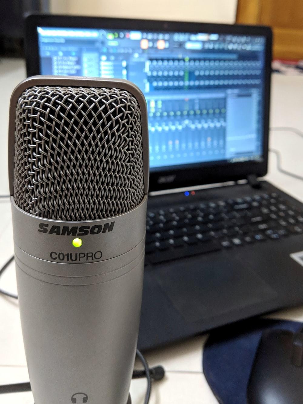 black laptop behind condenser microphone