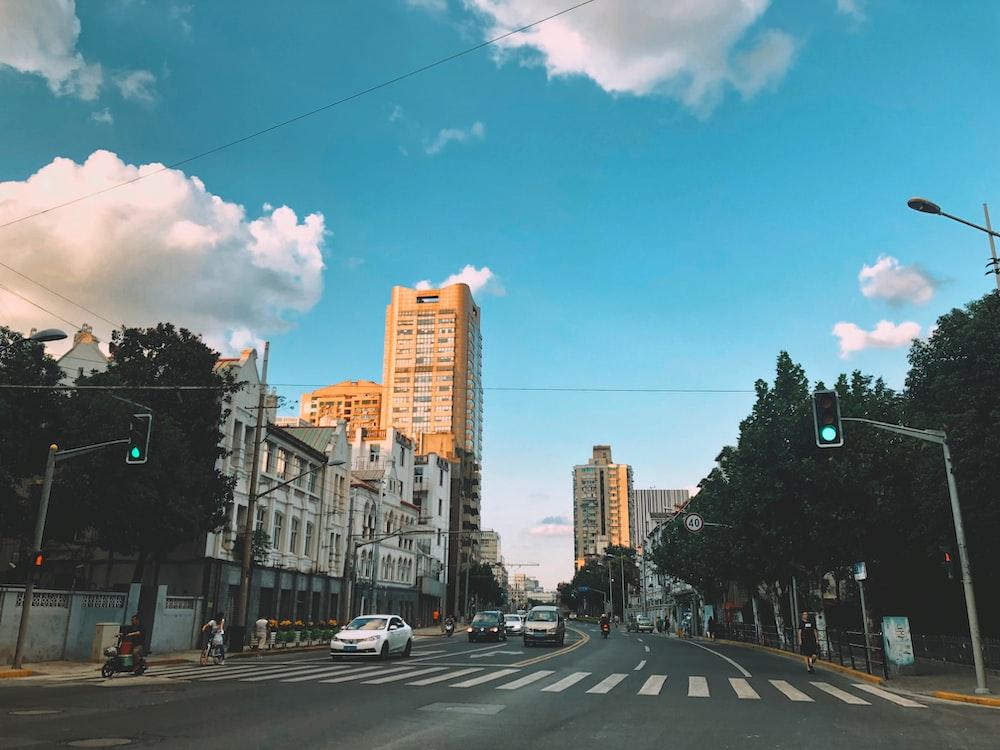 beige concrete high-rise building beside road