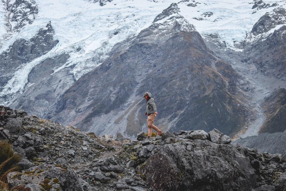 person walking near mountain during daytime
