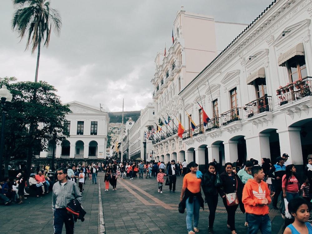people walking beside building at daytime