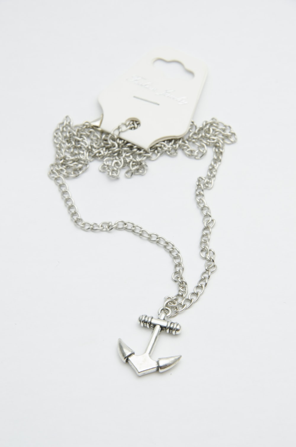 silver-colored pendant necklace
